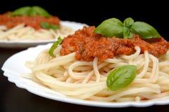 Close up pasta ragu alla bolognese sauce on black Stock Photos