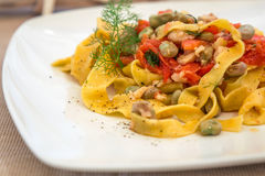 Close up pasta with seafood, tomatoes and vegetables. Pasta with seafood, tomatoes and vegetables royalty free stock photography