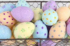 Close Up of Pastel-Colored Eggs in Chicken Wire Basket. Close up of hand-painted pastel-colored eggs in a chicken wire basket stock photos