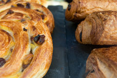 Close Up Pastries. Macro Close-Up of Danish Whirl & Chocoloate Croissant Stock Photo