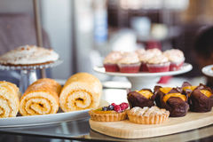 Close up of pastries on plates on counter Stock Image