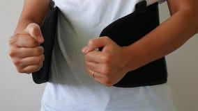 Close up patient Lumbar spondylosis. Close up patient Lumbar spondylosis with lumbar support on white wall royalty free stock photo