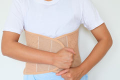 Close up patient Lumbar spondylosis with LS support on white b. Ackground stock photography