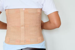 Close up patient Lumbar spondylosis with LS support on white b. Ackground stock photo