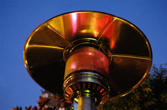 Close up of a patio heater. Focus is on the flame, day royalty free stock image