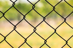Chain link fence. Close up on a pattern of chain link fence stock photo