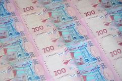 A close-up of a pattern of many Ukrainian currency banknotes with a par value of 200 hryvnia. Background image on business in Ukr. Aine royalty free stock photos