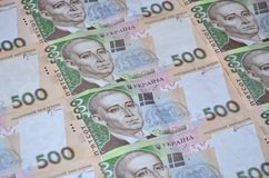 A close-up of a pattern of many Ukrainian currency banknotes with a par value of 500 hryvnia. Background image on business in Ukr. Aine Stock Photo