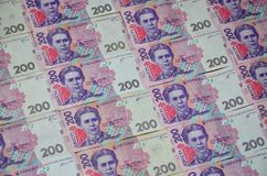 A close-up of a pattern of many Ukrainian currency banknotes with a par value of 200 hryvnia. Background image on business in Ukr. Aine Royalty Free Stock Photography