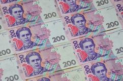 A close-up of a pattern of many Ukrainian currency banknotes with a par value of 200 hryvnia. Background image on business in Ukr. Aine royalty free stock images