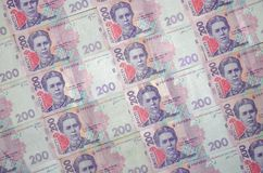 A close-up of a pattern of many Ukrainian currency banknotes with a par value of 200 hryvnia. Background image on business in Ukr. Aine Royalty Free Stock Image