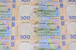 A close-up of a pattern of many Ukrainian currency banknotes with a par value of 500 hryvnia. Background image on business in Ukr. Aine Royalty Free Stock Photos