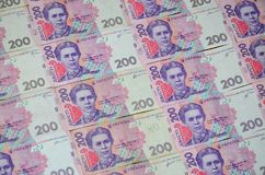 A close-up of a pattern of many Ukrainian currency banknotes with a par value of 200 hryvnia. Background image on business in Ukr. Aine stock photo