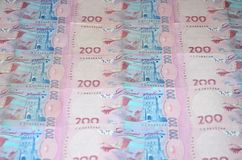 A close-up of a pattern of many Ukrainian currency banknotes with a par value of 200 hryvnia. Background image on business in Ukr. Aine Royalty Free Stock Photo