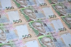 A close-up of a pattern of many Ukrainian currency banknotes with a par value of 500 hryvnia. Background image on business in Ukr. Aine Royalty Free Stock Photo