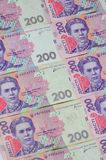 A close-up of a pattern of many Ukrainian currency banknotes with a par value of 200 hryvnia. Background image on business in Ukr. Aine stock photos