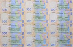 A close-up of a pattern of many Ukrainian currency banknotes with a par value of 500 hryvnia. Background image on business in Ukr. Aine Royalty Free Stock Image