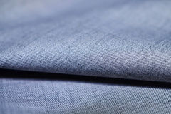 Close up pattern texture silver blue fabric of suit. Photo shoot by depth of field for object stock image