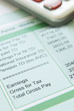 Close Up Of Pay Slip With Calculator Royalty Free Stock Photos