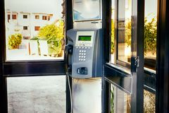 Close-up of payphone in the street. Close-up of payphone in telephone booth royalty free stock photography