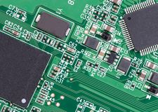 Close-up of PCB. Slightly covered in dust stock photo