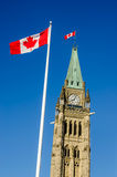 Close up of peace tower  in Ottawa, Canada. Close up of peace tower (parliament building) in Ottawa, Canada, with canadian, flags Royalty Free Stock Images