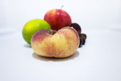 Close up of a peach in a fridge. royalty free stock photo