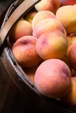 Close-up of peaches in a basket Stock Image