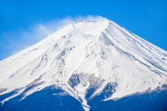 Peak of mount Fuji with snow cover on the top. Close up the peak of mount Fuji with snow cover on the top stock photo