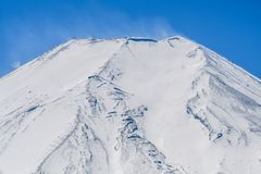 Peak of mount Fuji with snow cover on the top. Close up the peak of mount Fuji with snow cover on the top royalty free stock photo