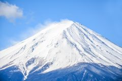 Peak of mount Fuji with snow cover on the top. Close up the peak of mount Fuji with snow cover on the top royalty free stock photos