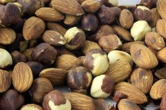 Peanuts and almonds stock photography