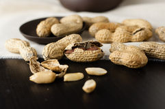 Close up peanuts. On a small plate and linen tablecloth stock photos