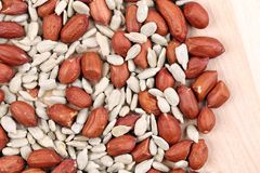 Close up of peanuts and sunflower seeds. Royalty Free Stock Photography