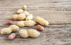 Close up peanuts on a wooden table Stock Photo