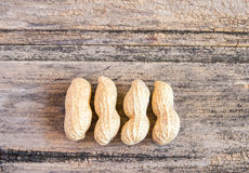 Close up peanuts on a wooden table Royalty Free Stock Image