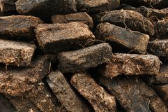 Close up of peat pile on Harris, Scotland. Close up of a pile of drying peat on Harris, Scotland Royalty Free Stock Images
