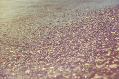 Close up of a pebble beach with the sea. Royalty Free Stock Image