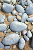 Close up of pebbles on a beach big blue stones Stock Image