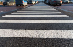 Close up of pedestrian crosswalk on city parking Royalty Free Stock Photography