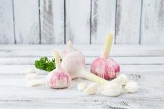 Close-up with peeled garlic Stock Image