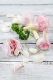 Close-up with peeled garlic Stock Photos