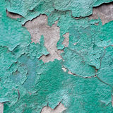 Close-up of peeling painted wall. Rustic green grunge material. Royalty Free Stock Images