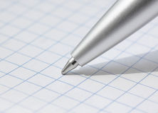 Close up of pen. At paper Royalty Free Stock Image