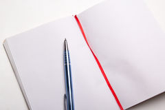 Close up of pen on blank note book Stock Images