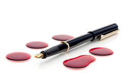 Close up of a pen and blood Royalty Free Stock Photos