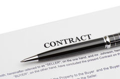 Close-up of pen on contract Stock Photography