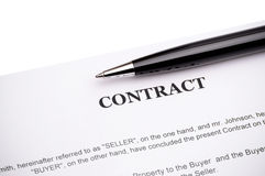 Close-up of pen on contract Stock Photos