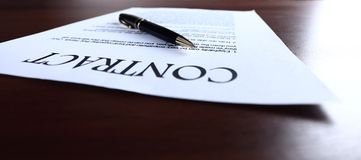 Close-up of pen on contract. Royalty Free Stock Image