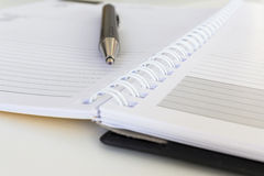Close-up of pen and diary calendar Royalty Free Stock Image